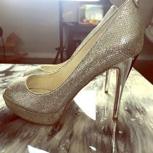 Michael kors heels , size 61/2 , silver color